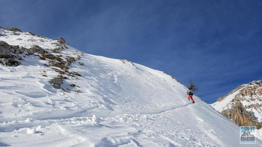Mountain with climbing splitboarder