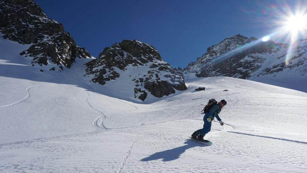 Splitboarding at Arlberg last turn of the run