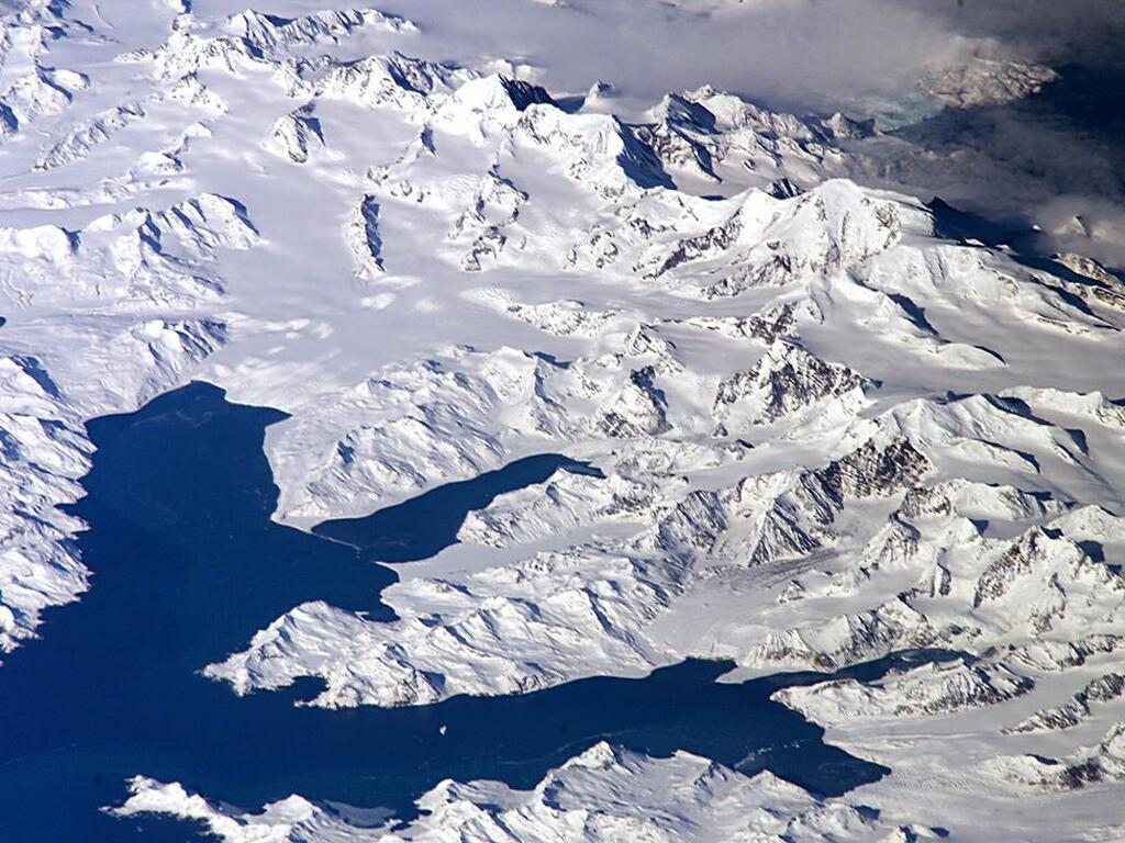 South Georgia - View of Cumberland Bay - with Thatcher Peninsula and King Edward Cove (Grytviken); and the Allardyce Range with the summit Mt. Paget - Photo courtesy of NASA: ISS011-E-12148