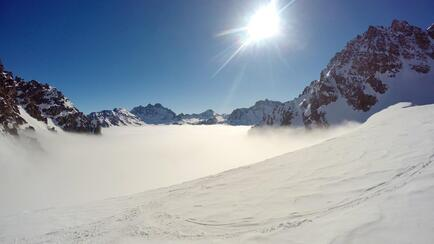 Sunshine on the Totenfeld and sea of fog down in the Jamtal.