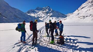 Mounting skins at Silvretta Lake. In the back on the right the Klostertal.